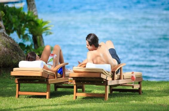Couple at playa cativo taking the sun